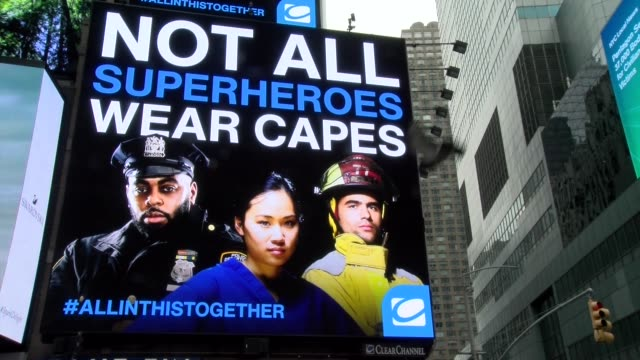 #we are all in this together - neon billboard during covid-19 crisis - billboard stock videos & royalty-free footage