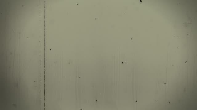 old film 4k gelb - 8mm filmprojektor stock-videos und b-roll-filmmaterial