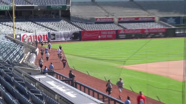 runners in yankee stadium 5k run on warning track around infield and outfield - salmini stock videos & royalty-free footage