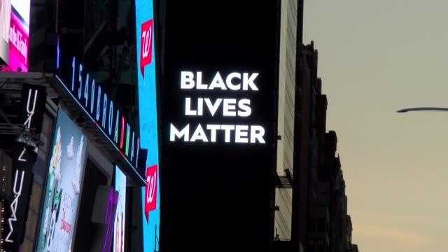 times square at sunset zoom out from black lives matter sign at epicenter of times square - salmini stock videos & royalty-free footage