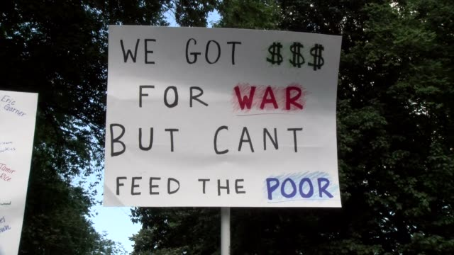 sign we got $ for war but can't fee the poor - salmini stock videos & royalty-free footage
