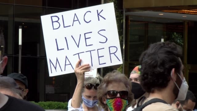 sign black lives matter sign with trump tower in background - salmini stock videos & royalty-free footage