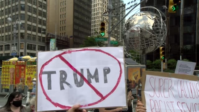 sign trump crossed out with trump plaza silver globe in background - salmini stock videos & royalty-free footage