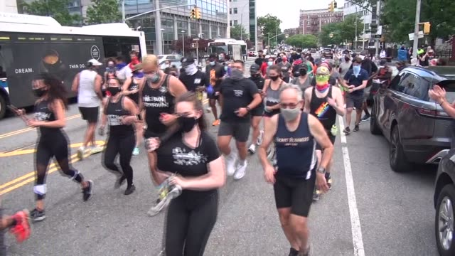 runners in masks head up st nichols avenue to broadway for a 5k out and back run - salmini stock videos & royalty-free footage