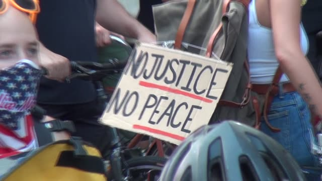 no justice no peace sign on bicycle - salmini stock videos & royalty-free footage