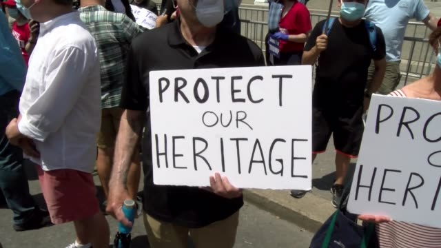 protect our heritage sign held by participant - salmini video stock e b–roll