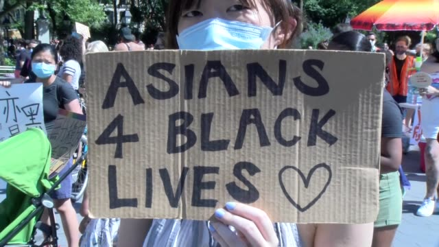 peaceful protestor holds sign asians 4 black lives - salmini stock videos & royalty-free footage