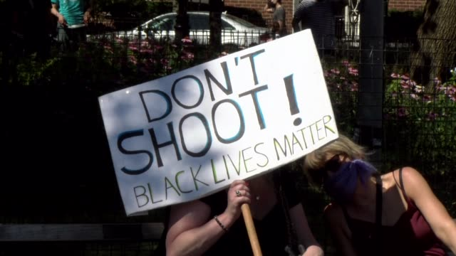 peaceful protestor hold sign don't shoot black lives matter - salmini stock videos & royalty-free footage