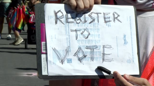 peaceful protestor holds sign register to vote - salmini stock videos & royalty-free footage