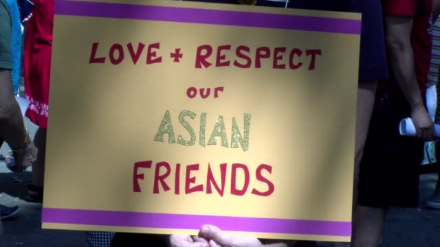 sign held by protester love respect our asian friends - salmini stock videos & royalty-free footage