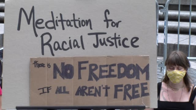 meditation for racial justice in columbus circle zoom out from sign - salmini stock videos & royalty-free footage