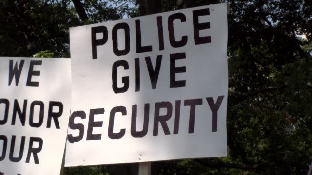 police give security banner - salmini stock videos & royalty-free footage