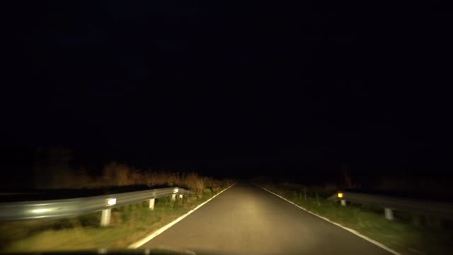 driving on national road at night - rustic stock videos & royalty-free footage