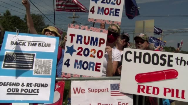 signs at trump rally - salmini stock-videos und b-roll-filmmaterial