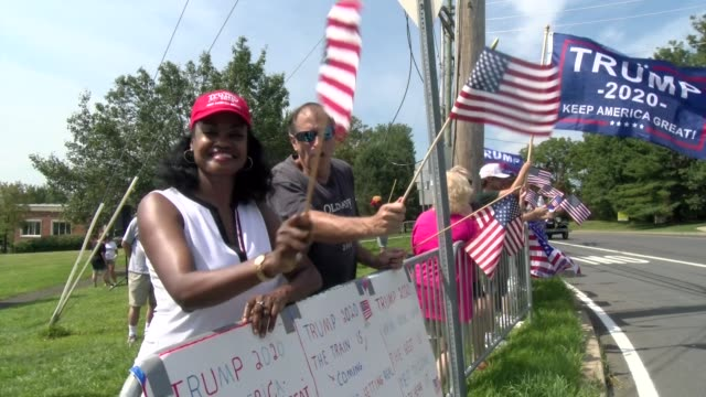rally participants wave american flags - salmini stock-videos und b-roll-filmmaterial