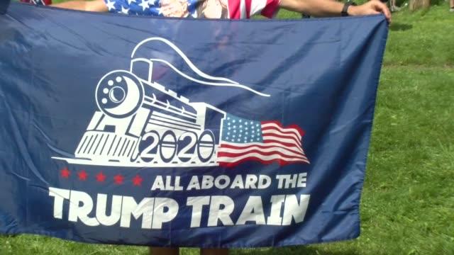 all aboard the trump train banner - salmini stock-videos und b-roll-filmmaterial