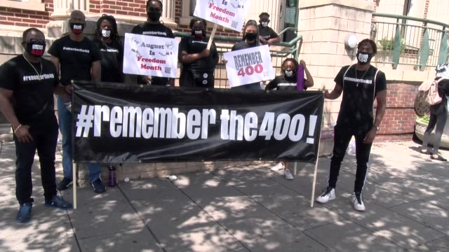 #remember the 400 banner carried by marchers - salmini stock videos & royalty-free footage