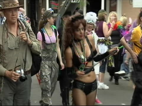 few shots people in costume walking down bourbon street during mardi gras fat tuesday - gras stock videos & royalty-free footage