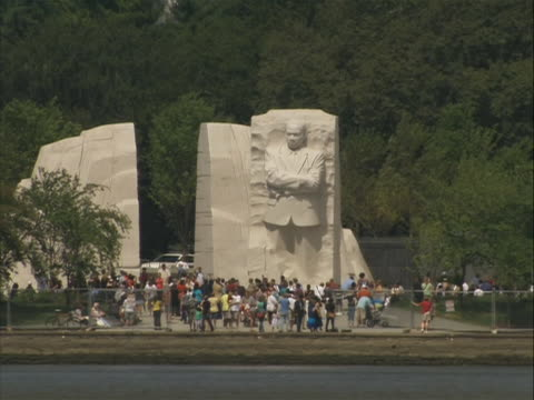 shot from across the water of the martin luther king jr. memorial in washington d.c. - engraved image stock videos & royalty-free footage