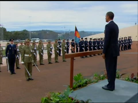 few shots of president obama arrival at australia parliament house ceremony he stands at podium and puts hand on his heart when the national anthem... - music or celebrities or fashion or film industry or film premiere or youth culture or novelty item or vacations stock videos & royalty-free footage