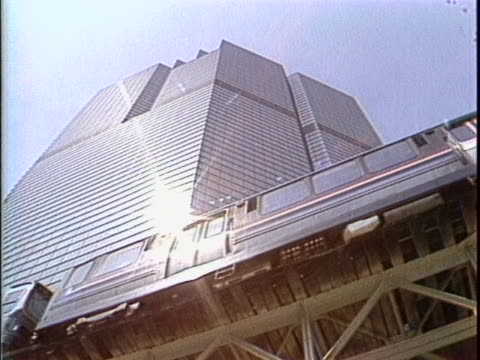 shots of piers on lake and wide shot of adler planetarium. lake shore drive and chicago skyline seen. close up of chicago subway on elevated track.... - chicago elevated stock-videos und b-roll-filmmaterial