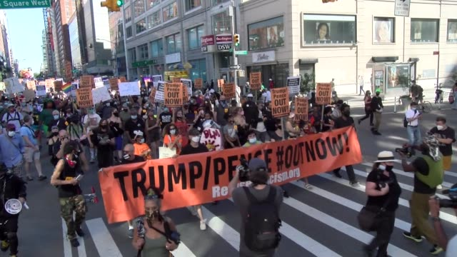 protest march begins heading west on 14th street - salmini video stock e b–roll