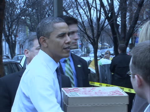 president obama walking out of pizzeria with 3 pizza boxes and shakes hands with people outside and saying merry christmas he is only wearing a shirt... - shirt and tie stock videos & royalty-free footage