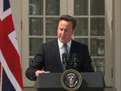 british prime minister david cameron sot at press conference with president barack obama ms of cameron with british flag behind him this is outside... - united states and (politics or government) stock videos & royalty-free footage
