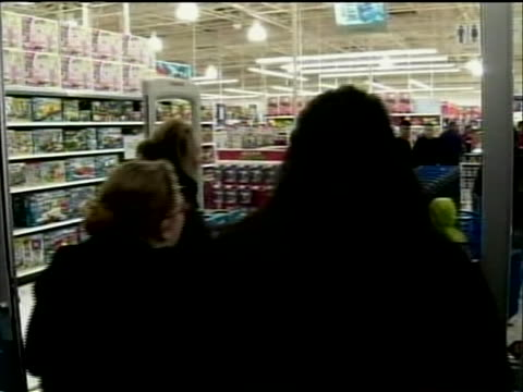 people rushing into toys r us store on black friday as doors open they grab carts and go into store - toys r us stock videos & royalty-free footage