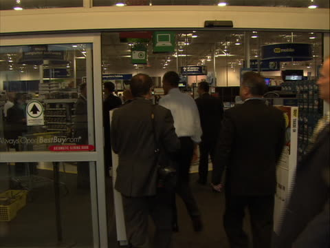 president obama walking into best buy store for holiday shopping for his daughters he is only wearing a shirt and tie no jacket there are security... - shirt and tie stock videos & royalty-free footage