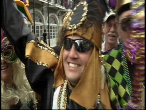 man in costume gives sot about mardi gras on bourbon street during mardi gras sot mardi gras is a time for carnivale dress as you please the freaks... - gras stock videos & royalty-free footage