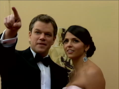 actor matt damon at the 82nd academy awards with wife luciana bozan barroso. both posing for photographs on the red carpet of the kodak theatre. he... - luciana barroso video stock e b–roll