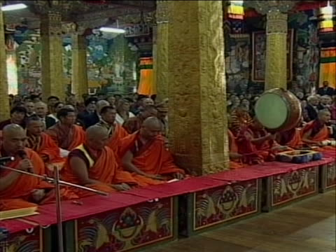 side shots of monks playing musical instruments during ceremony - religious dress stock videos & royalty-free footage