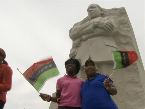 low angle shot of two women posing for a photograph in front of the stone of hope from the martin luther king jr. memorial. - engraved image stock videos & royalty-free footage