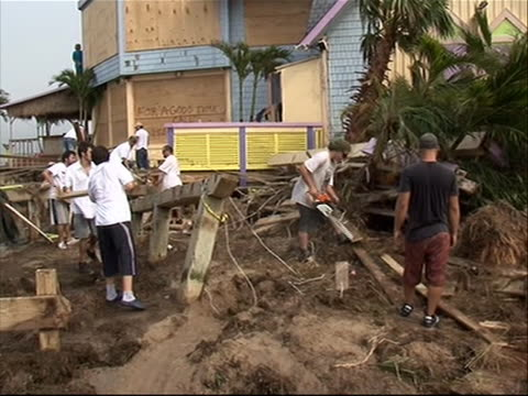 people cleaning up sawing debris in north carolina in aftermath of hurricane irene - north carolina us state stock videos & royalty-free footage
