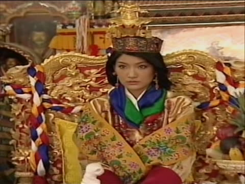pull out from of crown to jetsun pema wearing crown sitting on throne - religious dress stock videos & royalty-free footage