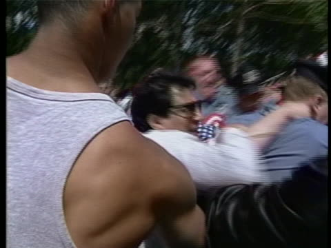 gotti supporters seen trying to overturn us marshals car with smashed windshield. police officer seen being shoved in angy mob - united states and (politics or government) stock videos & royalty-free footage
