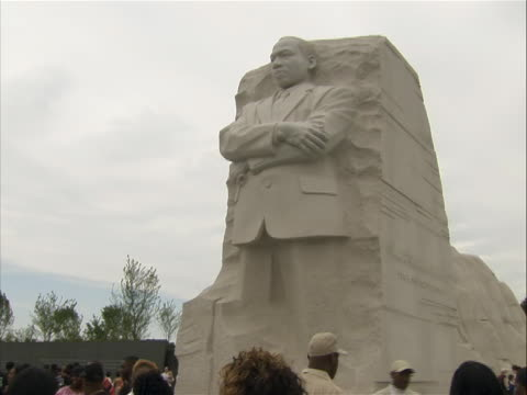 martin luther king jr. memorial visitors in front of the 'stone of hope'. - engraved image stock videos & royalty-free footage