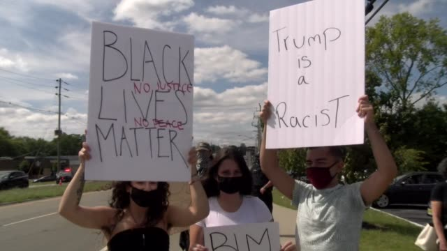 trump is a racist sign - salmini stock videos & royalty-free footage