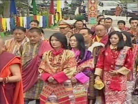 side angle people walking in formal dress can see jetsun pema in crowd - religious dress stock videos & royalty-free footage