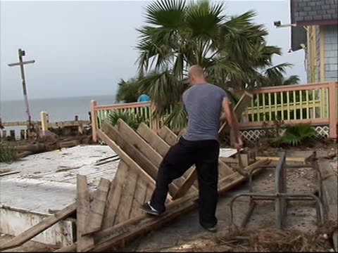 man cleaning up wood in north carolina in aftermath of hurricane irene - north carolina us state stock videos & royalty-free footage