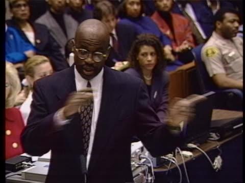 prosecutor darden at podium as prosecutors clark& hodgman;& defense lawyers bailey; douglas; cochran;& defendant simpson listen as darden says its... - ジョニー コクラン点の映像素材/bロール