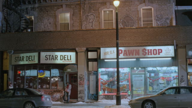 nx - apartment over pawn shop and delicatessen - 2004 stock videos & royalty-free footage