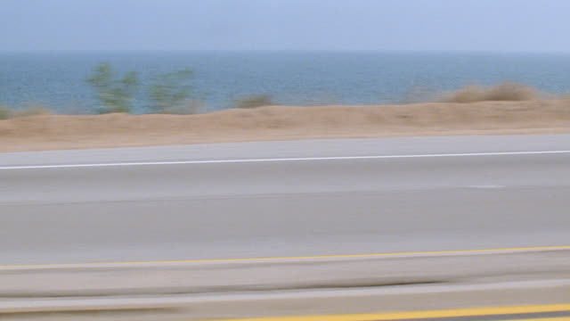 dx-cars street cars-scenic coastline-cars traffic-california-cars runbys-santa barbara-moving pov's - santa barbara california stock videos & royalty-free footage