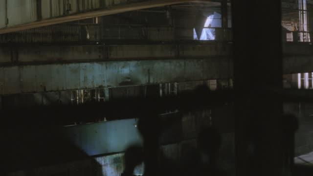 nx - int. factory - warehouse - helicopter - warehouse点の映像素材/bロール