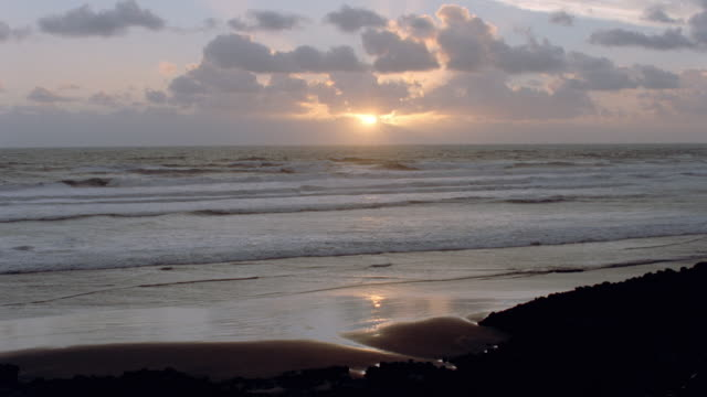 sunset - clouds, shoreline, island, ocean, fog - golden hour stock videos & royalty-free footage