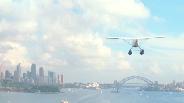 dx - air to air - aviation mov.p.o.v. - australia / sydney - bridges - sailboats - 1999 stock videos & royalty-free footage
