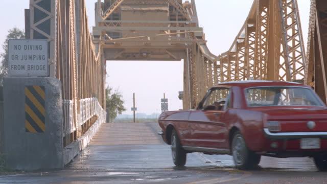 sunset - metal draw bridge - mustang - drawbridge stock videos & royalty-free footage