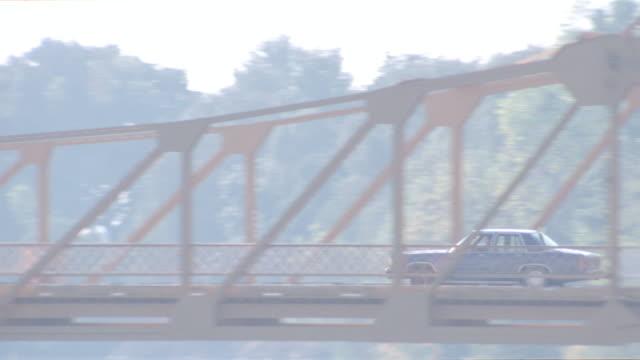 sunset - metal draw bridge - ford sedan + mustang - drawbridge stock videos & royalty-free footage
