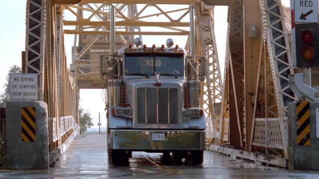 sunset - metal draw bridge - ford sedan + semi-truck - drawbridge stock videos & royalty-free footage